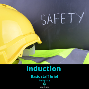 Yellow safety helmet and vest with the word SAFETY on a black board